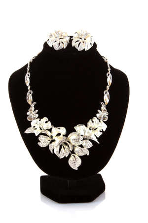 silver jewellery: Necklace and earrings  with flowers on mannequin isolated on white