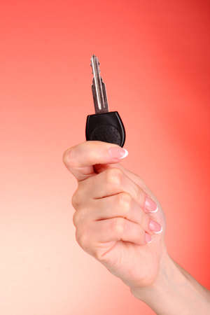 Woman hand with keys on red background Stock Photo - 8812656