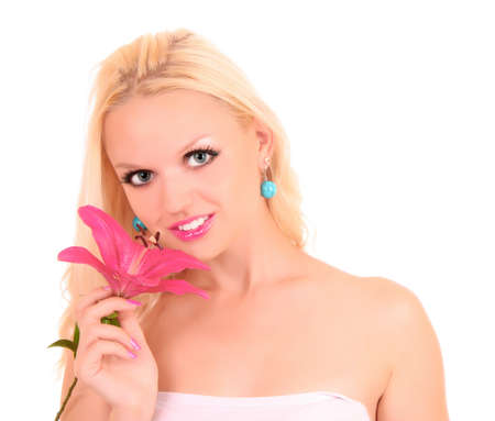 Beautiful young woman with pink lily flower. Isolated on white background photo