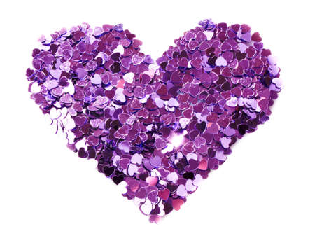 Violet hearts  in the form of confetti on white photo