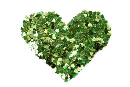 Green hearts  in the form of confetti on white photo