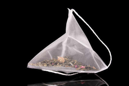 Close-up of tea bag  on black background Stock Photo - 8910680
