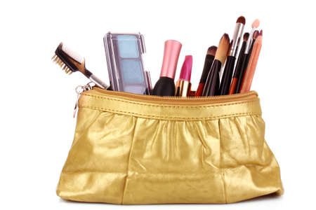 cosmetics bag with cosmetic on white photo