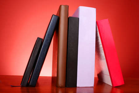 stack of colorful books on the table photo