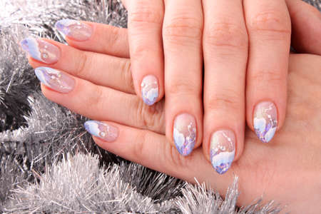 Nails with beautiful winter design on white photo
