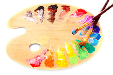 wooden art palette with blobs of paint and a brush on white background Stock Photo - 8983116