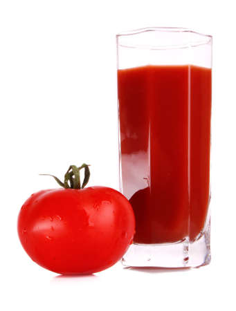 Glass of fresh tomato juice and tomatoes  round the glass  on the table photo