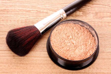 cosmetic brush and powder photo
