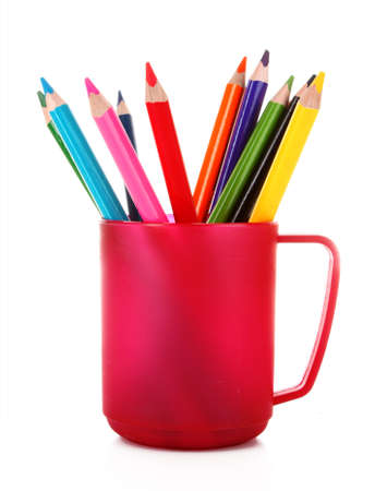 Many colorful pencils in the cup  on the white background photo