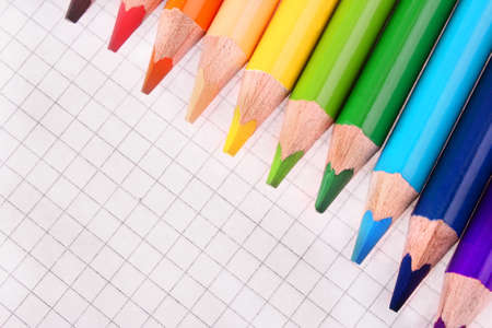 Color pencils isolated on white background photo