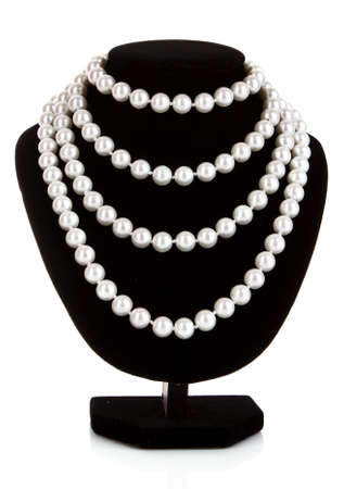 Pearl necklace on black mannequin photo