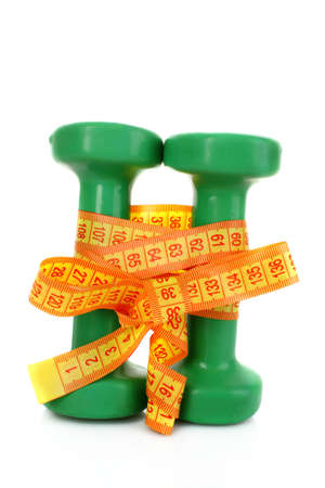 Green Dumbbells and tape measure  on the white background photo