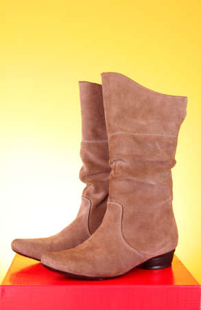 Suede boots  on the red background Stock Photo - 9033363