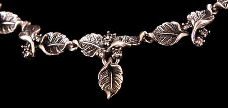 Necklace with leaves on black photo