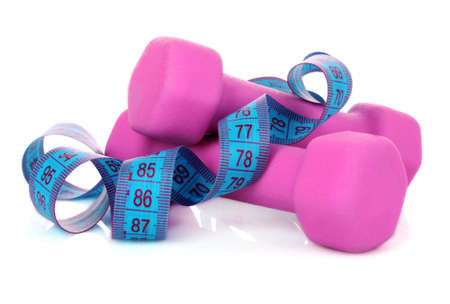 Dumbbells and tape measure  on the white background Stock Photo - 9097321