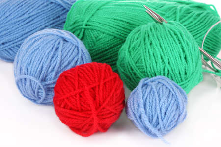 Knitting yarn and  knitting needles on white photo