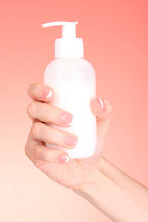 Woman applying cream on her hand Stock Photo - 9149242