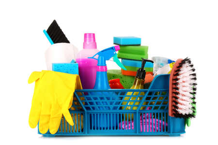 Cleaning supplies in basket on white background photo