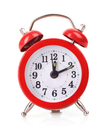 Red old style alarm clock isolated on white background photo