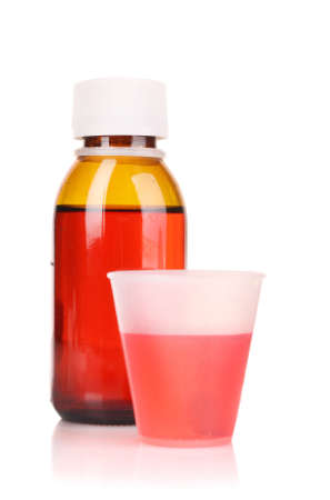 Cough medicine bottle  with poured dose on counter Stock Photo - 9210956