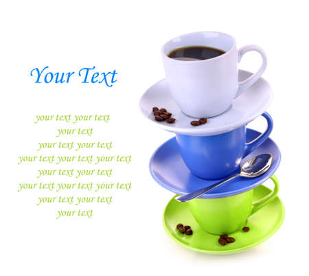Color cups with coffee, and spoon on   white background photo