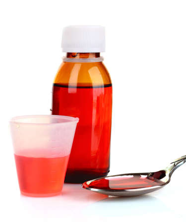 syrup: Cough medicine bottle  with poured dose on counter Stock Photo