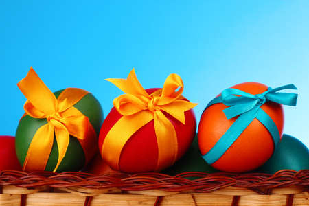 three presents: Easter eggs with  bows isolated on white