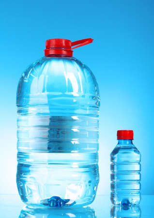Bottles of water on blue background Stock Photo - 9211261