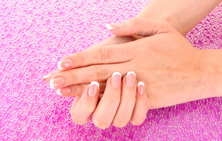 Beautiful woman hands with french manicure on pink background Stock Photo - 9251116