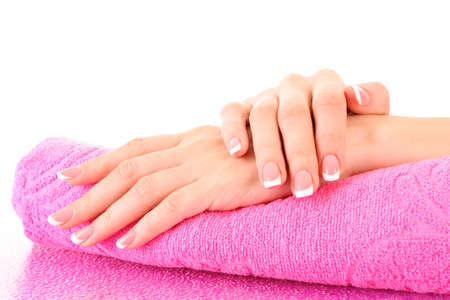 manicured hands: Beautiful woman hand with french manicure on pink background Stock Photo