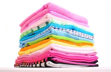 white clothing: Pile of colorful clothes over white background