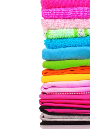 Pile of colorful clothes over white background Stock Photo - 9251241