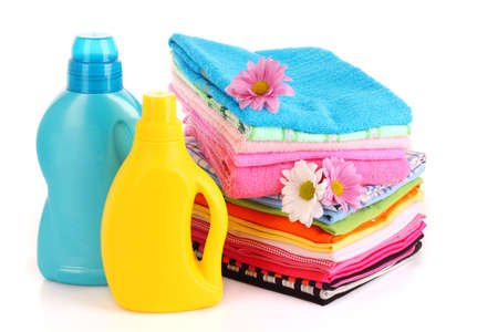 detergent: Pile of colorful clothes over white background