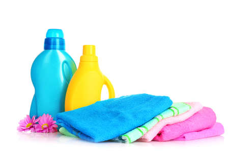 laundry detergent: Colorful towels and liquid laundry detergent   over white background