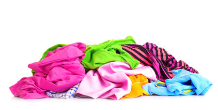 Big heap of colorful clothes   isolated on white background photo
