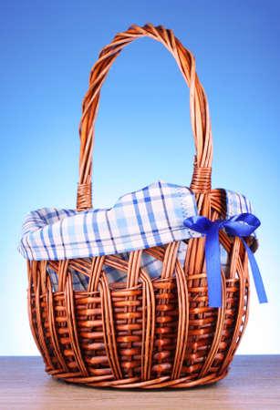 cepelia: wicker basket  on blue background