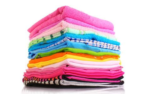 Pile of colorful clothes over white background Stock Photo - 9318569
