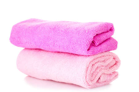 Pink stacked bathroom towels on a white background photo