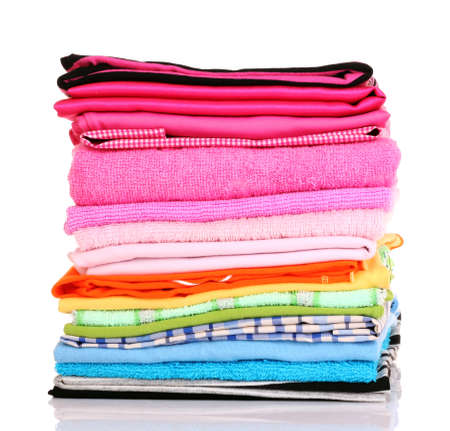 ropa casual: Pila de ropas coloridas sobre fondo blanco