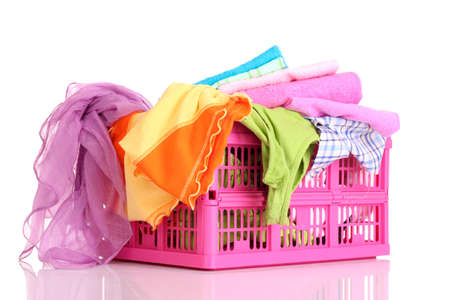 Bright clothes in a laundry basket on white background Stock Photo - 9476003