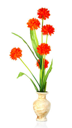 Artificial orange flowers in a vase photo