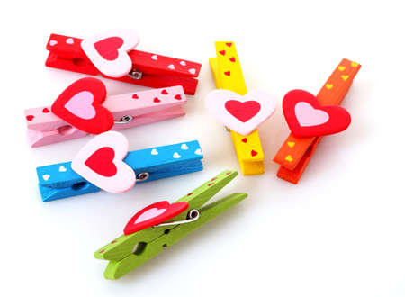 wooden clothes pins with hearts photo