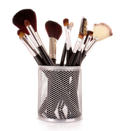 make up products: cosmetic brushes in cup white