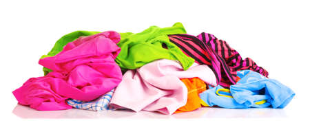 Big heap of colorful clothes   isolated on white background Stock Photo - 9520475