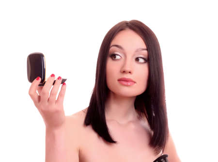 Beautiful young woman with  hand mirror photo
