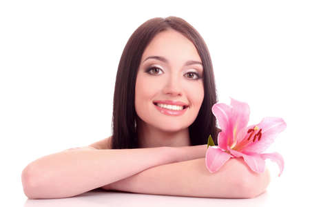Beautiful young woman with lily flower Stock Photo - 9579472