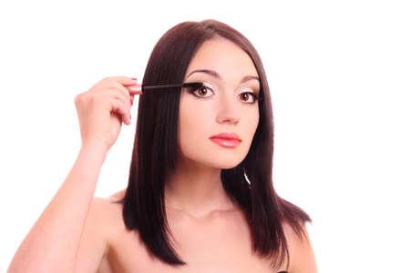 Beautiful young woman with mascara brush photo