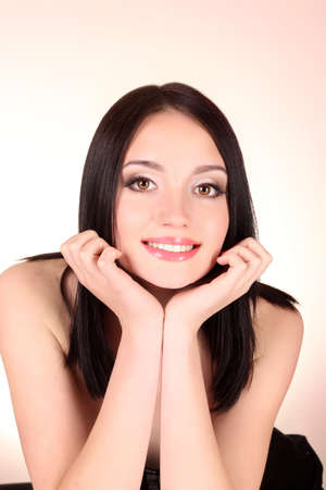 Beautiful young smiling woman with healthy skin and great teeth Stock Photo - 9579442