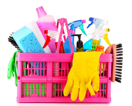 solvent: Cleaning supplies in basket on white background Stock Photo