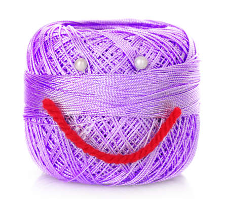 Thread bobbin with smile isolated white photo